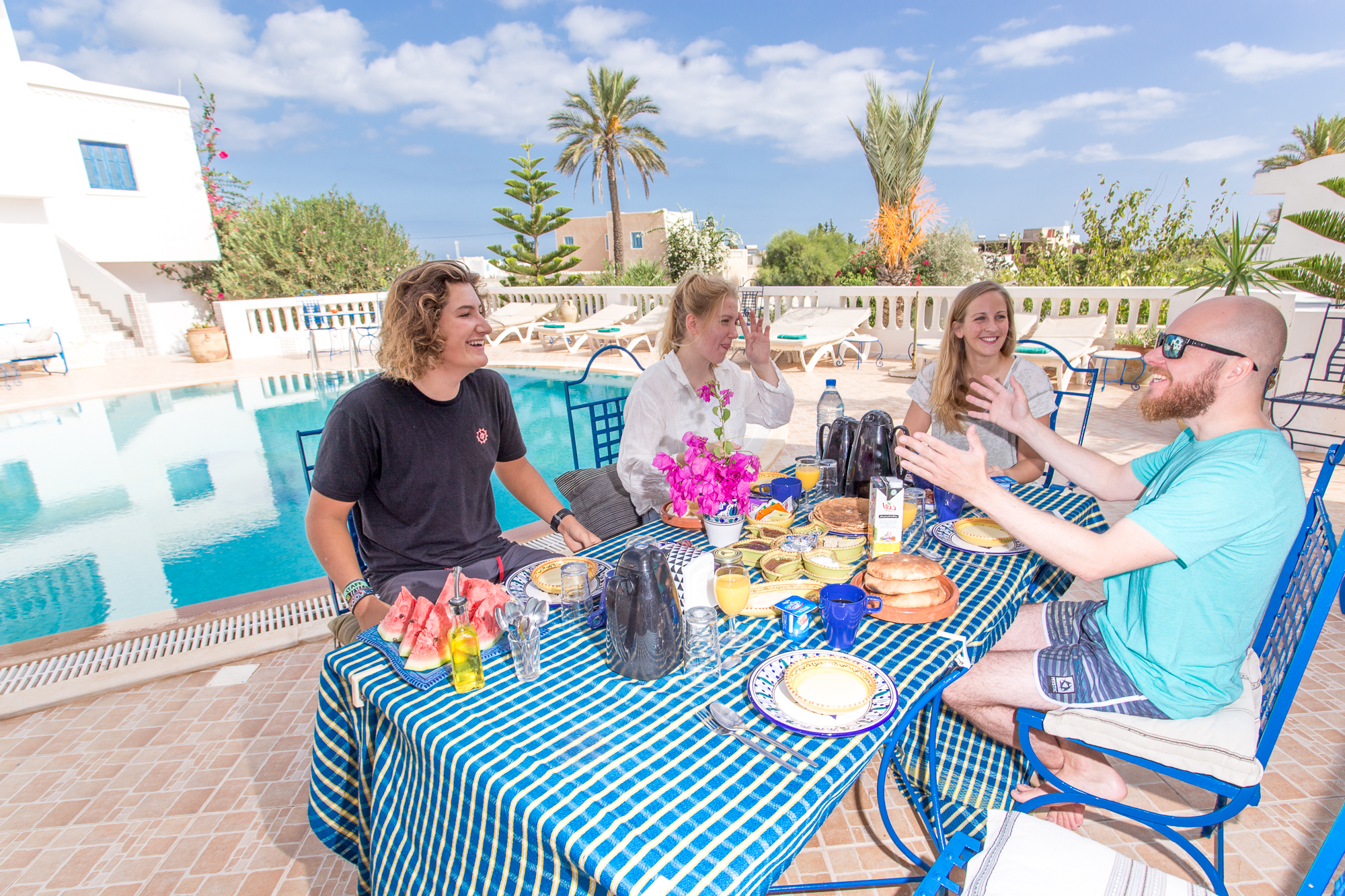 Thordis (2nd from the left) and the others at breakfast by the pool
